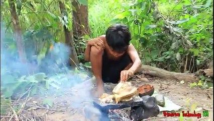 Primitive_Technology_-_Eating_delicious_-_Cooking_chicken_and_eggs_on_a_rock