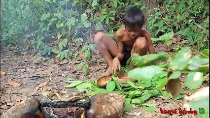 Primitive_Technology_-_Eating_delicious_-_Cooking_eel_on_a_rock