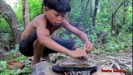 Primitive_Technology_-_Eating_delicious_-_Awesome_cooking_stingray_on_a_rock