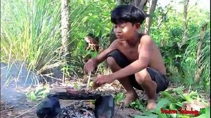 Primitive_Technology_-_Eating_delicious_-_Awesome_cooking_pork_cow_on_a_rock